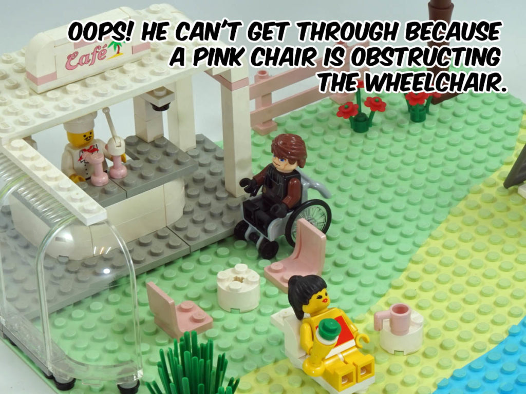 Oops! He can't get through because a pink chair is obstructing his wheelchair.