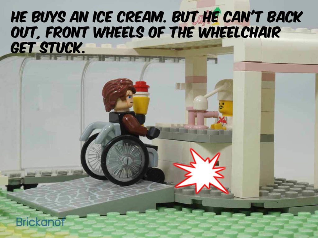 He buys an ice cream, but the front wheels of his wheelchair get stuck. He can't back out.